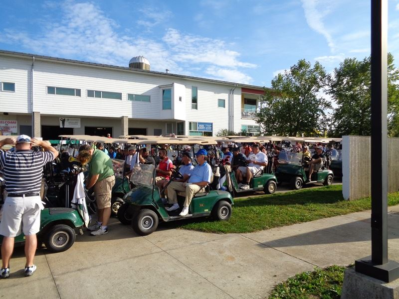 Participants of the golf outing lined up before the event starts