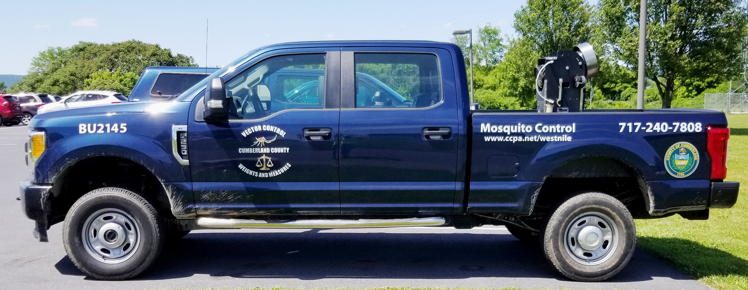 Vector Control's blue 2019 pickup truck, used for mosquito control