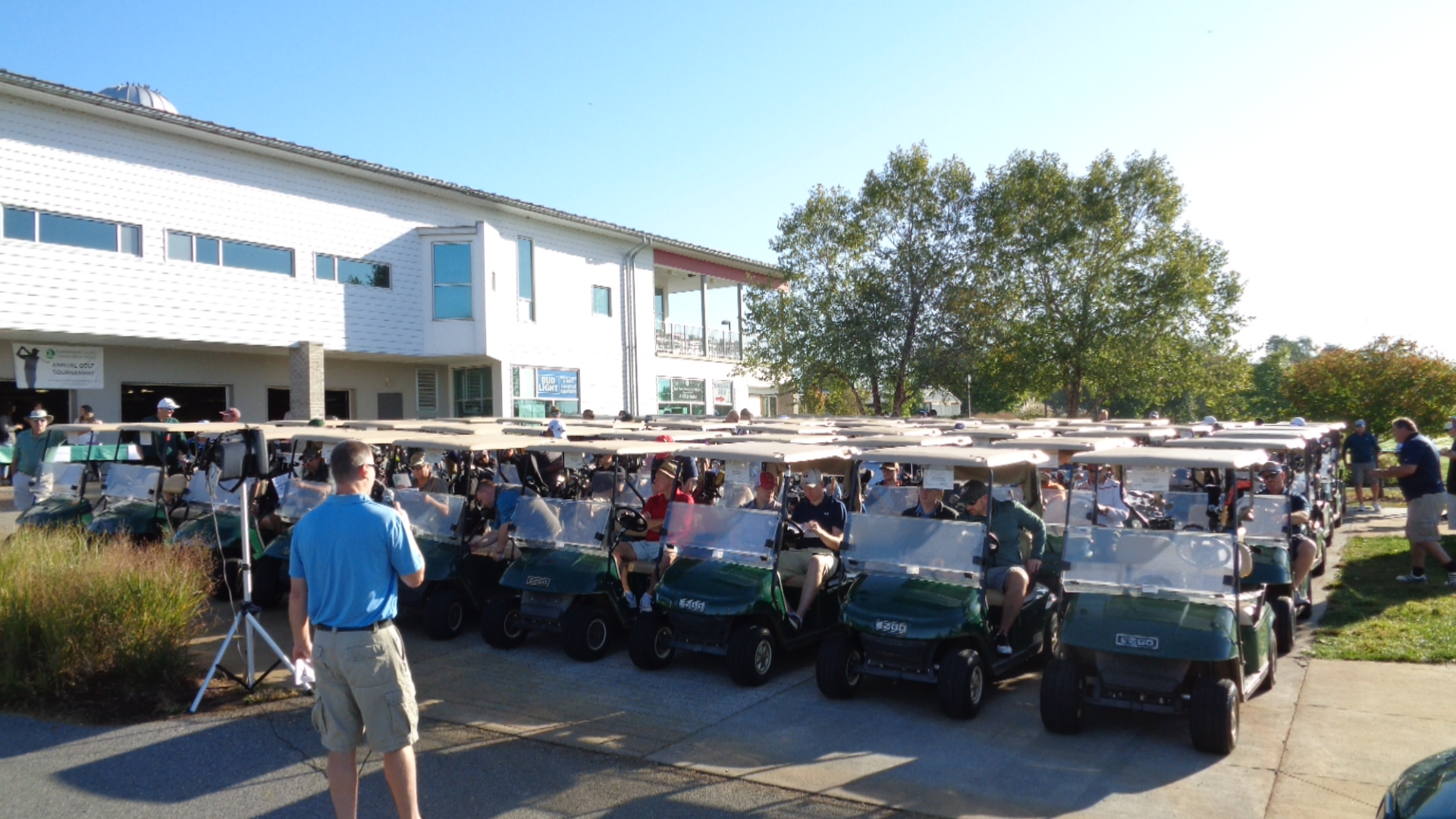 2019 Golf Tournament Welcome with golfers in carts
